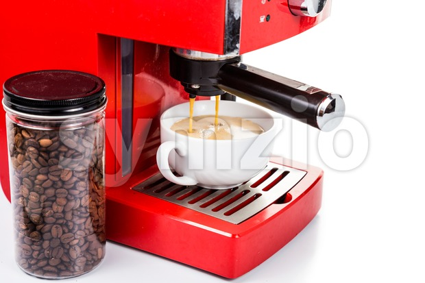 Brewing coffee with a red color espresso coffee machine Stock Photo