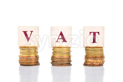 VAT or Value Added Tax concept with stack of coins and letters Stock Photo