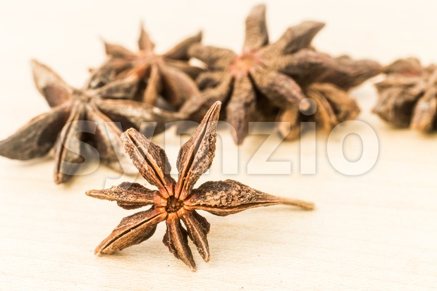 Close up and selective focus on one piece of Star Anise at the foreground Stock Photo