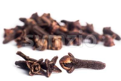 Close up and selective focus on three pieces of dried cloves Stock Photo