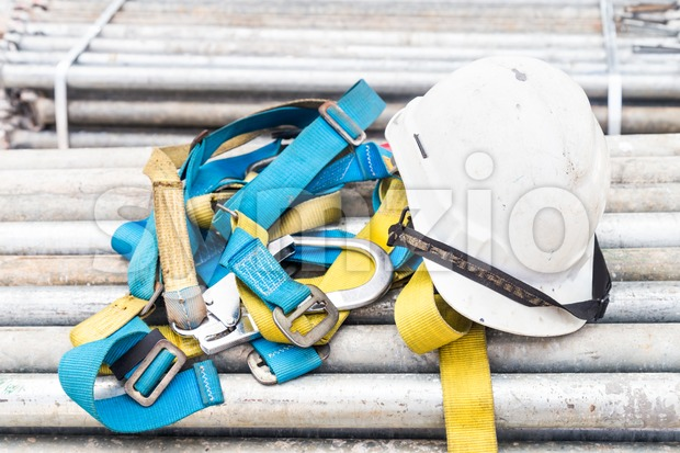 Afety helmet and harness at a construction site
