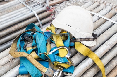 afety helmet and harness at a construction site Stock Photo