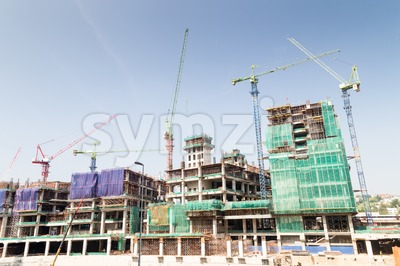 Construction of large complex with multiple tower crane on site Stock Photo