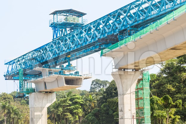Construction of a mass transit train line in progress with heavy infrastructure. This photo shows the progress in joining the various blocks/modules Stock Photo