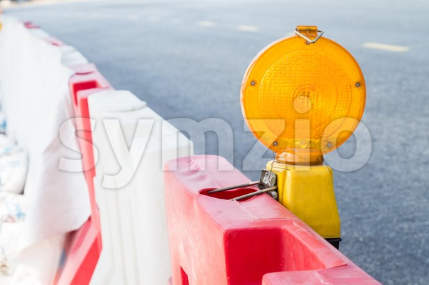 Construction site hazard warning light installed on road shoulders as safety caution