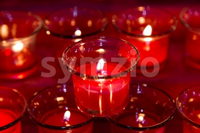 Tea lights in glass jar illuminates a dark surrounding Stock Photo