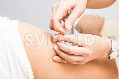 Series of medical doctor penetrating injection syringe into arm of patient Stock Photo