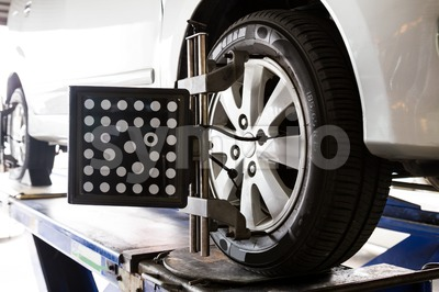 Wheel alignment of a vehicle in progress Stock Photo