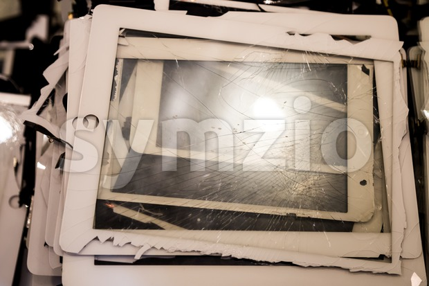 Stack of damaged and shattered smart tablet pad computer screen Stock Photo
