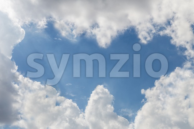 Double heart shaped blue sky due to cloud formation Stock Photo