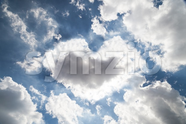 Natural heart shaped cloud formation against blue sky Stock Photo