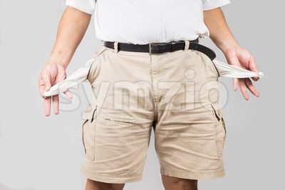 Depressed man in short pants pull out and show his empty pants pockets Stock Photo