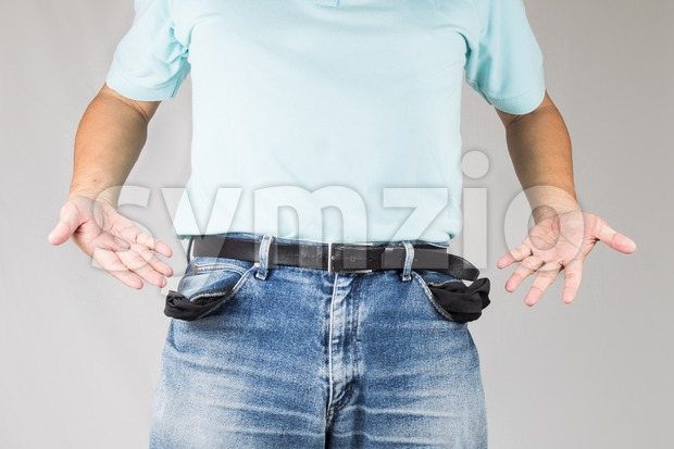 Depressed man pull out and show his empty pants pockets