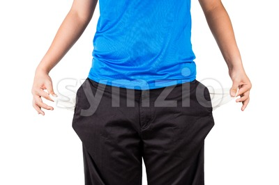 Teenager pull out and show his empty pants pockets Stock Photo