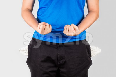 Teenager with empty pockets tighten his fists in show of frustration Stock Photo