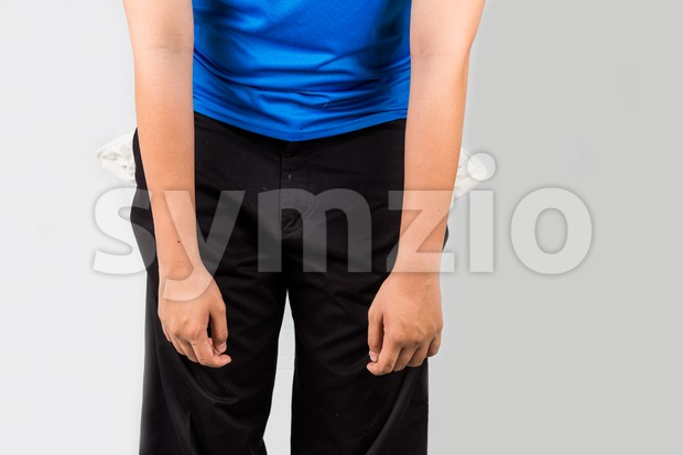 Teenager with empty pockets in depressed and demotivated posture Stock Photo