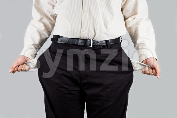 Depressed man pull out and show his empty pants pockets Stock Photo