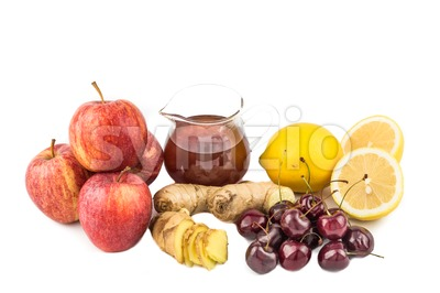 Common home remedy to treat gout inflammation - Cherries, Lemon Juice, Apple Cider Vinegar, Ginger Roots. Stock Photo
