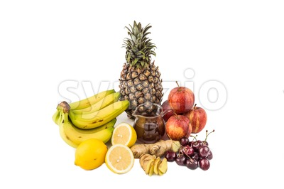 Common home remedy to treat gout inflammation - Cherries, Lemon Juice, Apple Cider Vinegar, Banana, Pineapple, Ginger Roots. Stock Photo