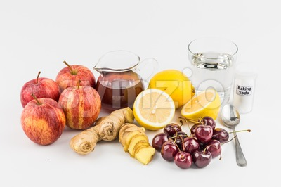 Common home remedy to treat gout inflammation - Cherries, Lemon Juice, Apple Cider Vinegar, Ginger Roots, Baking Soda. Stock Photo