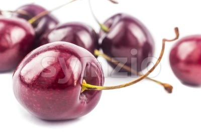 Closeup on fresh and juicy cherry with white background Stock Photo