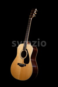 Contemporary acoustic guitar against dark background Stock Photo