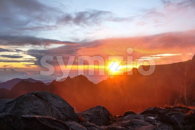Beautiful and scenic sunrise on the summit peak of Mount Kinabalu, Sabah Stock Photo