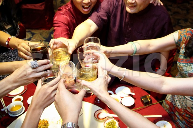 Congratulating and toasting during dinner, the Chinese way Stock Photo