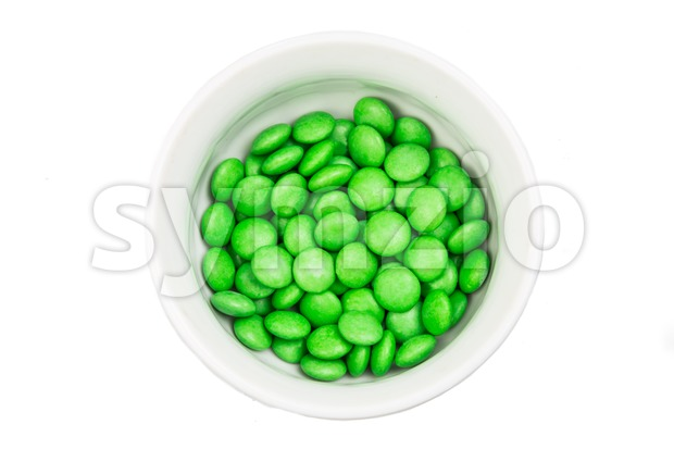 Overhead view bowl of green chocolate candy in white background Stock Photo