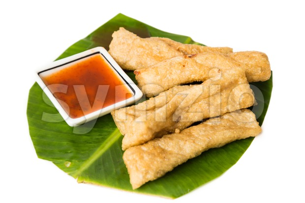 A serving of fried fish stick or keropok lekor, a popular snack in Malaysia. Stock Photo