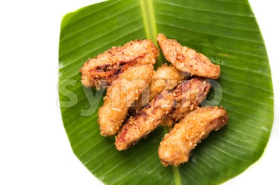 A serving consisting of the combination of fried banana (pisang goreng), a popular snack in Malaysia, Singapore, Indonesia and Thailand Stock Photo