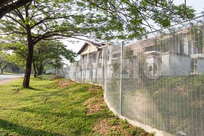 Security fencing at residential housing neighborhood Stock Photo