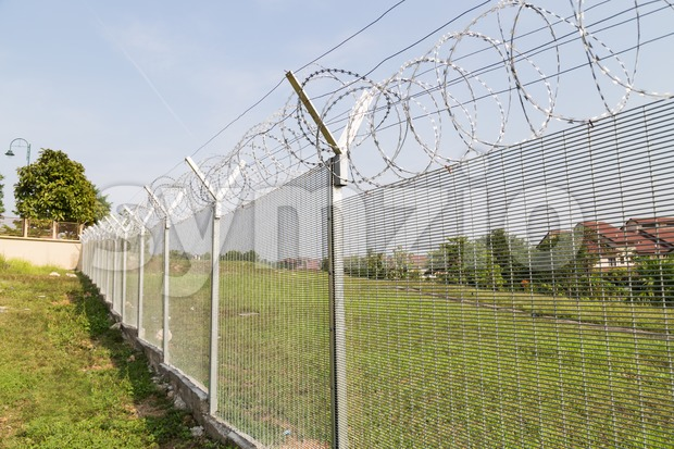 Security fencing at residential housing neighborhood