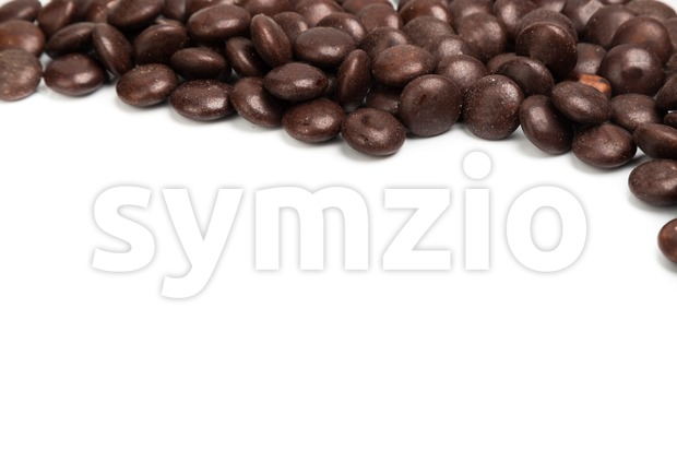Top right frame of brown chocolate candy on white background Stock Photo
