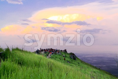 Crowd hike and gather on the summit of Bukit Broga for sunrise Stock Photo