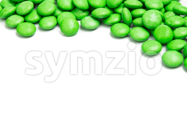 Top right frame of green chocolate candy on white background Stock Photo