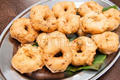 Uluntu Vadai, a popular Southern Indian deep fried snack Stock Photo