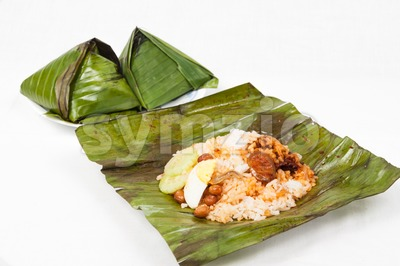 Simple and authentic delicious nasi lemak wrapped in banana leaf Stock Photo