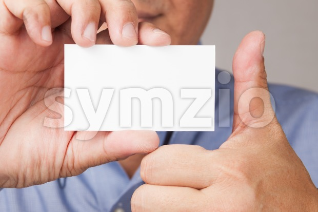 Businessman with blank placard and thumb up Stock Photo