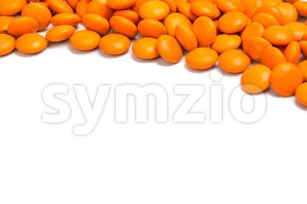 Top right frame of orange chocolate candy on white background Stock Photo