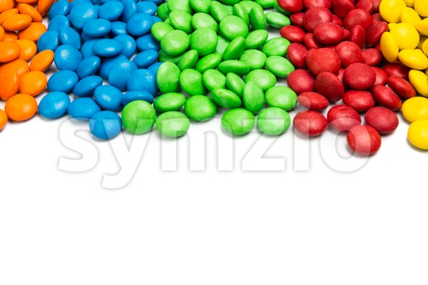 Close up colorful chocolate candy on white background with space Stock Photo