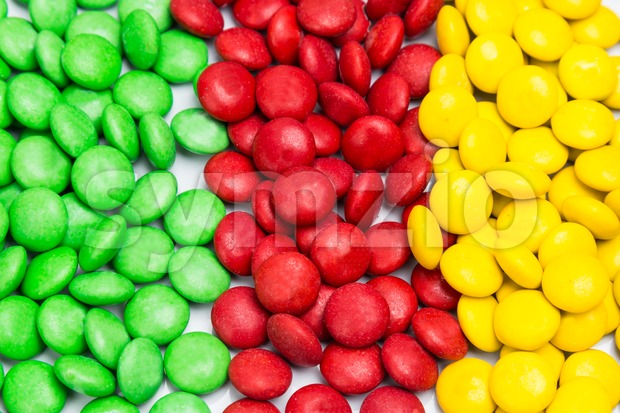 Pile of colorful chocolate candy by color in rows column Stock Photo