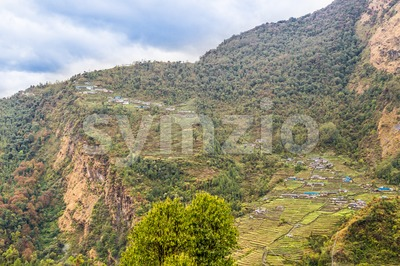 Overview of upper and lower Chomrong village, Nepal Stock Photo