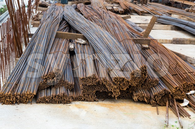 Bundle of reinforced metal steel rods at construction site ready for deployment