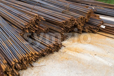 Bundle of reinforced metal steel rods at construction site Stock Photo