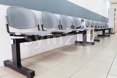 Closeup on row of empty chairs at reception of interior Stock Photo