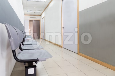 Row of empty chairs at reception of an interior office building Stock Photo