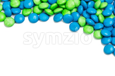 Top rame of blue green chocolate candy on white background Stock Photo