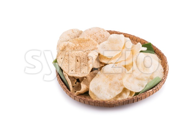 Freshy fried delicious prawn and fish crackers on rattan tray Stock Photo