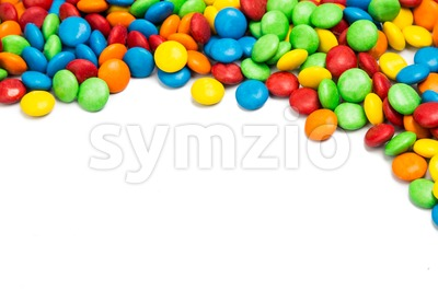 Top right frame of colorful chocolate candy on white background Stock Photo